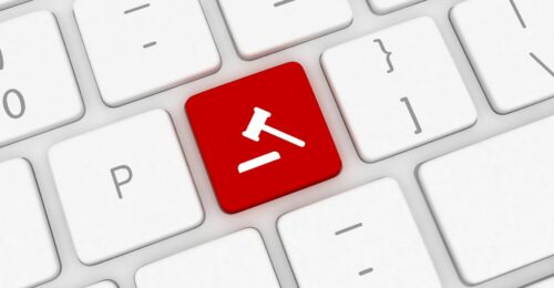 a close up of a keyboard graphic, where one of the keys is bright red with a white gavel icon in the middle.