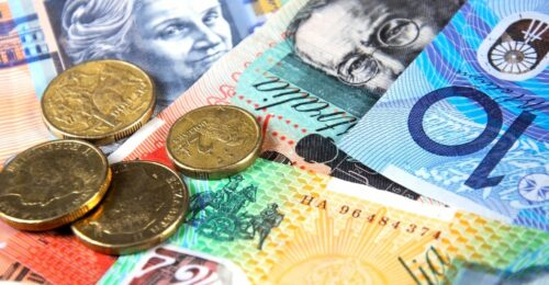 a close up photo of australian money - a ten dollar note, a twenty dollar note, a one hundred dollar note, a fifty dollar note, a two dollar coin and three one dollar coins.