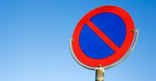 A red 'no' sign against a blue sky background