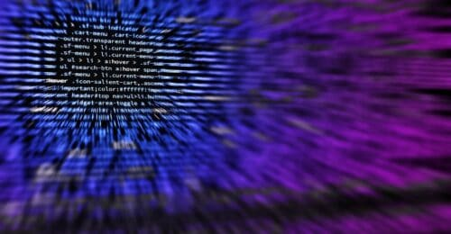 screen full of generic code that is blurred around the edges with a blue and purple hazy overlay