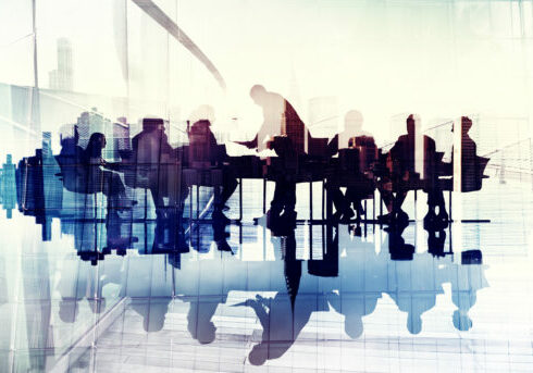 Abstract,Image,Of,Business,People's,Silhouettes,In,A,Meeting